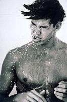 Young naked man under shower