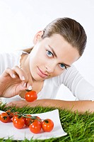young woman eating tomatoes