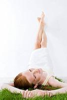 beauty woman laying on grass