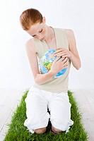 woman watching globe