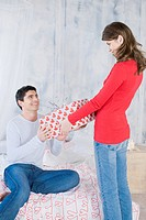 Woman giving man a present