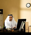 Arab man working at office