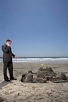 Businessman Discussing Sandcastle