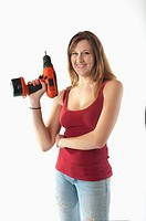 Woman with cordless screwdriver