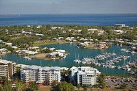 Aerial of waterside apartments and houses around Cullen Bay Marina