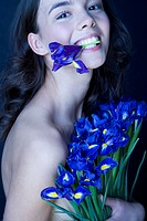 beauty brunette with iris in mouth