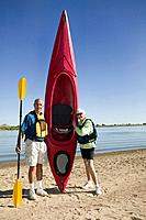 Senior Couple on Shore with Kayak