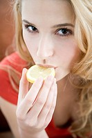 woman biting lemon