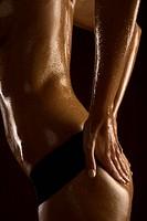 woman applying oil on her bottom