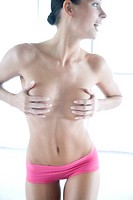 woman covering breast