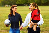 Mother and Father with Daughter on Soccer Field
