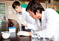 Male chemistry students making an experiment in a laboratory
