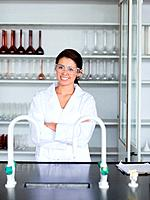 Portrait of a smiling science student posing in a laboratory