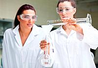 Gorgeous scientists doing an experiment in a laboratory