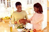 Women Making Salad in Kitchen