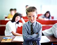 Boy Standing in Front of Class