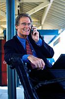Businessman Telephoning at Train Station