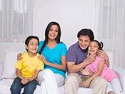 Parent with children sitting on sofa MR779P , MR779Q , MR779R , MR779S