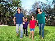 Parent with children on grass lawn , Mumbai, India, Asia MR779P , MR779Q , MR779R , MR779S