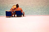 Couple Lounging on Beach Chairs