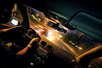 view of the inside of a car. Driving in the night