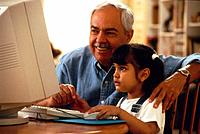 Man and grandfather using home computer