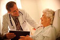 Doctor visiting elderly patient in her room