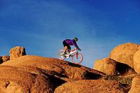 Mountain biker on a boulder