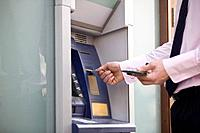 A businessman using a cash machine (thumbnail)