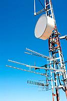 Antenna repeater messy mast with tv radio and telephone