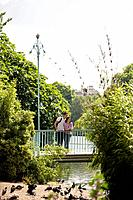 A young couple standing on a bridge in St James Park (thumbnail)