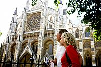 A middle_aged couple looking at Westminster Abbey, London