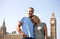 A middle_aged couple standing in front of Big Ben, arm in arm
