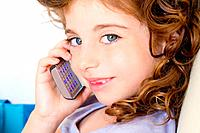 Blue eyes child girl talking mobile phone smiling indented