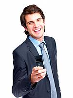 Portrait of a joyful young business man holding a cellphone against white background