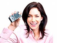 Closeup portrait of a joyful young woman displaying her mobile phone against white background