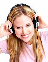 Closeup portrait of a beautiful young lady listening to music on headphones against white background