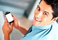 Top view of man smiling while holding cell phone