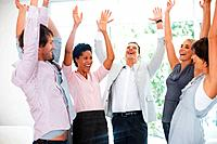 Group of business people raising hands in joy