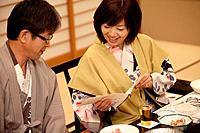 Mature Couple Looking at Menu at Dinner Table