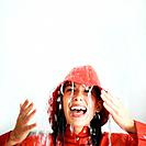 Woman getting rained on indoors