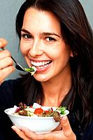 Happy woman ready to eat salad