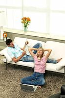 Young Couple Relaxing in Living Room
