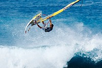 Hawaii, Maui, Ho´okipa, Windsurfer catches big air off wave. FOR EDITORIAL USE ONLY.