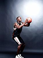Portrait of a young and strong Afroamerican man playing basketball