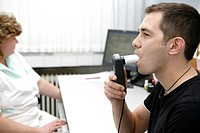 Young man on a spirometry examination