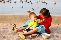 Vietnamese girl with her sister Mui Ne, Vietnam.