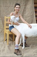 young woman with white goat, Slovakia