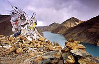 Pile of prayer flags and scarfs at Lake Yamdrok_Tso, Tibet