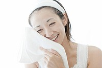 Woman drying her face with a towel, Tokyo Prefecture, Japan